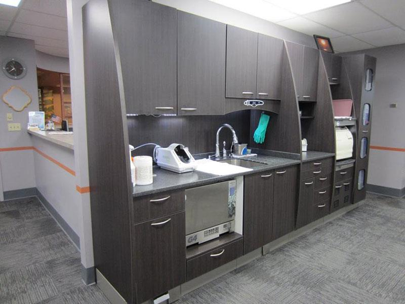 Kennedy Dental Group back office with shelves and a sink